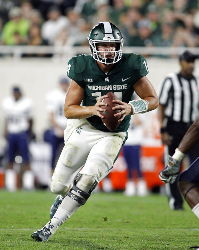 FILE - In this Aug. 31, 2018, file photo, Michigan State quarterback Brian Lewerke scrambles against Utah State during the fourth quarter of an NCAA college football game in East Lansing, Mich. It's been an up-and-down season for Lewerke, who now faces the nation's top-ranked pass defense when the Spartans take on Michigan this weekend. (AP Photo/Al Goldis, File)