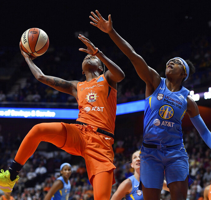 Connecticut Sun guard Courtney Williams puts up a shot around Chicago Sky guard Diamond DeShields in WNBA Eastern Conference action Friday, September 6, 2019 at Mohegan Sun Arena. The Sun dropped the 109-104 loss in overtime in their home season finale. (Sean D. Elliot/The Day via AP)