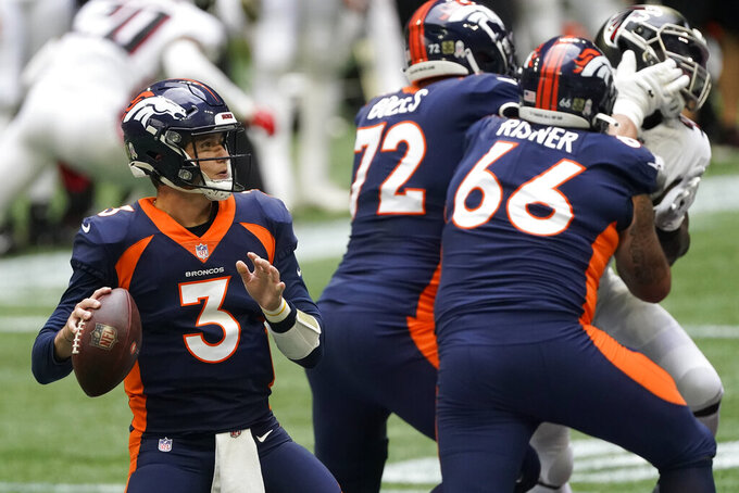 Denver Broncos quarterback Drew Lock (3) works in the pocket against the Atlanta Falcons during the first half of an NFL football game, Sunday, Nov. 8, 2020, in Atlanta. (AP Photo/John Bazemore)