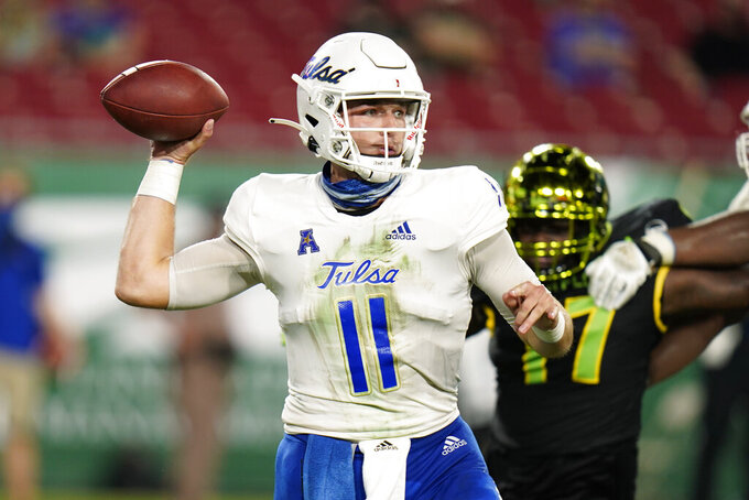 Tulsa quarterback Zach Smith throws a pass against South Florida during the first half of an NCAA college football game Friday, Oct. 23, 2020, in Tampa, Fla. (AP Photo/Chris O'Meara)