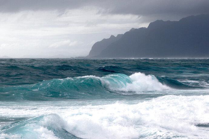 Waves break as Tropical Storm Olivia approaches Oahu, Wednesday, Sept. 12, 2018 in Laie, Hawaii. (AP Photo/Caleb Jones)