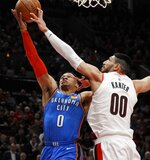 Oklahoma City Thunder guard Russell Westbrook, left, has his shot blocked by Portland Trail Blazers center Enes Kanter, right, during the first half of Game 1 of a first-round NBA basketball playoff series in Portland, Ore., Sunday, April 14, 2019. (AP Photo/Steve Dipaola)