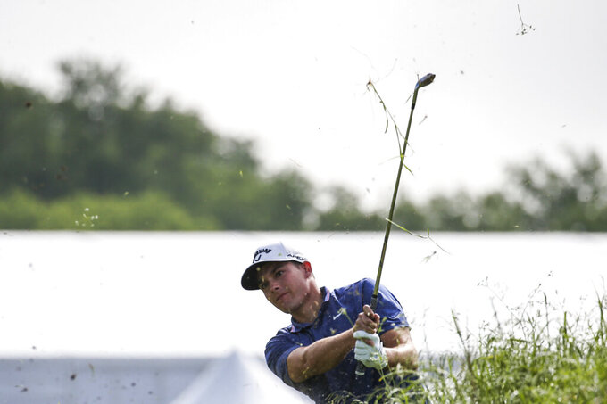 Aaron Wise hits a shot out of the rough toward the 18th hole during the first round of the Byron Nelson golf tournament Thursday, May 9, 2019, at Trinity Forest in Dallas. (Ryan Michalesko/The Dallas Morning News via AP)