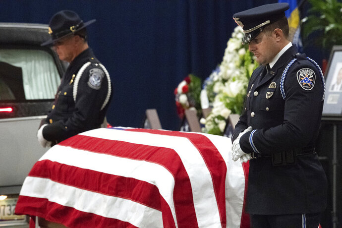 Officers from Arizona police departments stand watch at the casket at the Tucson Convention Center in Tucson, Ariz., for the Celebration of Life ceremony for fallen U.S. Marshal Deputy Chase White on Friday, Dec. 7, 2018. White was shot and killed while serving an arrest warrant on Nov. 29. (Shane T. McCoy/U.S. Marshals Service via AP)