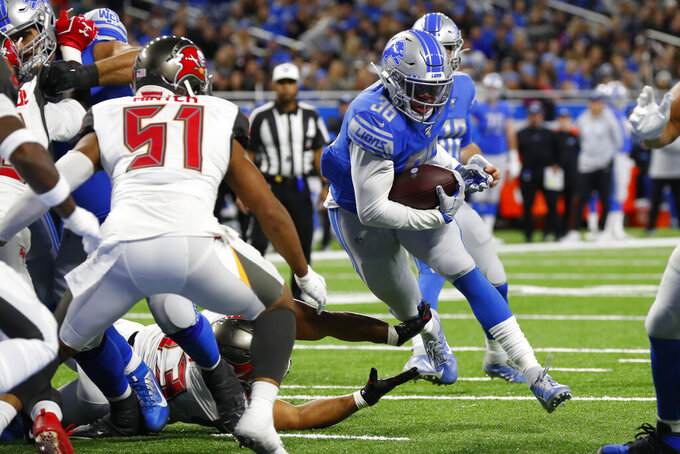 Detroit Lions running back Wes Hills runs into the end zone for a touchdown during the second half of an NFL football game against the Tampa Bay Buccaneers, Sunday, Dec. 15, 2019, in Detroit. (AP Photo/Paul Sancya)