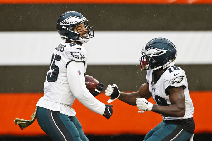 Philadelphia Eagles tight end Richard Rodgers, left, celebrates with wide receiver Jalen Reagor after scoring a 19-yard touchdown during the second half of an NFL football game against the Cleveland Browns, Sunday, Nov. 22, 2020, in Cleveland. (AP Photo/Ron Schwane)
