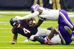 Houston Texans quarterback Deshaun Watson (4) is sacked by Minnesota Vikings defensive tackle Jaleel Johnson (94) during the second half of an NFL football game Sunday, Oct. 4, 2020, in Houston. (AP Photo/David J. Phillip)