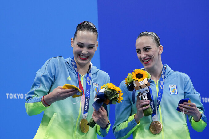 Third placed Marta Fiedina and Anastasiya Savchuk of Ukraine celebrate during the medal ceremony of the duet free routine final at the the 2020 Summer Olympics, Wednesday, Aug. 4, 2021, in Tokyo, Japan. (AP Photo/Alessandra Tarantino)