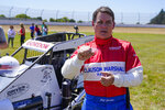 Jeff Gordon, a five-time winner of the Brickyard 400 and four-time NASCAR Cup Series champion, talks about driving a USAC midget car before taking some exhibition laps on the dirt track in the infield at Indianapolis Motor Speedway in Indianapolis, Thursday, June 17, 2021. (AP Photo/Michael Conroy)