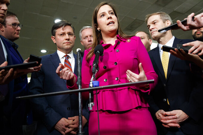 FILE - In this Jan. 23, 2020, file photo Rep. Elise Stefanik, R-N.Y., center, accompanied by from left, Rep. Mike Johnson, R-La., Rep. Mark Meadows, R-N.C., Rep. Lee Zeldin, R-N.Y. and Rep. Jim Jordan, R-Ohio, speaks to the media before the impeachment trial of President Donald Trump on Capitol Hill in Washington. Conservatives in and out of Congress are expressing opposition to Stefanik's rise toward House Republicans' No. 3 leadership job. House Republicans plan to meet privately next week, and seem certain tooust Rep. Liz Cheney, R-Wyo., from that top post.(AP Photo/ Jacquelyn Martin, File)