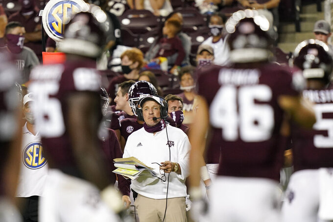 "FILE - Texas A&M coach Jimbo Fisher watches from the sideline during the second half of an NCAA college football game against Vanderbilt in College Station, Texas, in this Saturday, Sept. 26, 2020, file photo. The SEC came into this season with a contingency plan to deal with coronavirus-related issues. While those plans have been severely tested as the pandemic has wreaked havoc, Southeastern Conference officials continue adapting to navigate setbacks in their pursuit of a league title and possible national championship. ""Life is about changes,"" Texas A&M Jimbo Fisher said. ""It's about adaptation. It's about making the best out of situations.""(AP Photo/David J. Phillip, File)"
