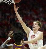 Utah forward Mikael Jantunen (20) shoots over Minnesota's Daniel Oturu during an NCAA college basketball game Friday, Nov. 15, 2019, in Salt Lake City. (Francisco Kjolseth/The Salt Lake Tribune via AP)