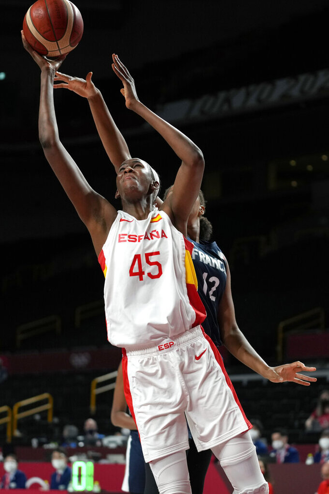Spain's Astou Ndour (45) drives to the basket ahead of France's Iliana Rupert (12) during a women's basketball quarterfinal round game at the 2020 Summer Olympics, Wednesday, Aug. 4, 2021, in Saitama, Japan. (AP Photo/Eric Gay)