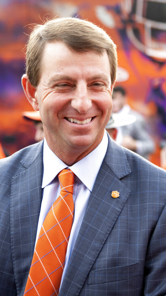 Clemson head coach Dabo Swinney arrives for a Tiger Walk to greet fans before an NCAA college football game against Boston College, Saturday, Oct. 2, 2021, in Clemson, S.C. (AP Photo/Hakim Wright Sr.)