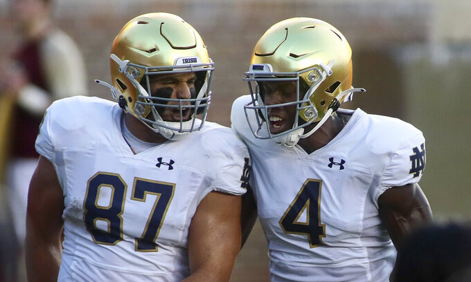 Notre Dame tight end Michael Mayer (87) celebrates his touchdown with teammate wide receiver Kevin Austin Jr. (4) against Florida State in the first quarter of an NCAA college football game Sunday, Sept. 5, 2021, in Tallahassee, Fla. (AP Photo/Phil Sears)