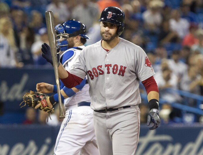 Boston Red Sox' J. D. Martinez strikes out against the Toronto Blue Jays during the seventh inning of a baseball game, Wednesday, Sept. 11, 2019 in Toronto. (Fred Thornhill/The Canadian Press via AP)