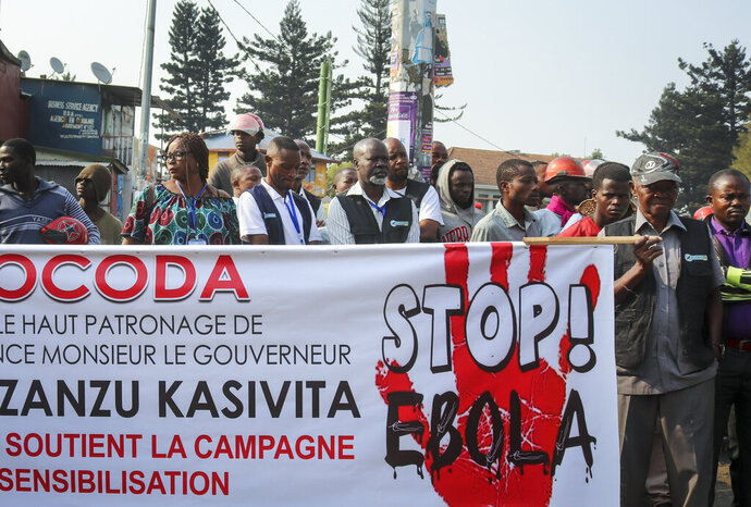 Residents march to raise awareness about Ebola, in the city of Goma, in eastern Congo Thursday, Aug. 22, 2019. Hundreds gathered in Goma to support Ebola response teams that have seen increasing attacks and resistance among communities where Ebola continues to spread after killing at least 1,800 people in the year since the outbreak began. (AP Photo/Justin Kabumba)