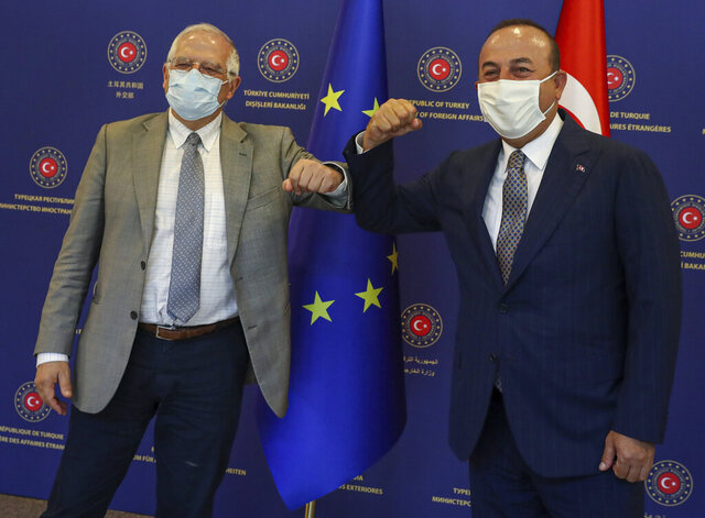 Turkey's Foreign Minister Mevlut Cavusoglu, right, and Josep Borrell Fontelles, High Representative and Vice-President of the European Commission, greet each other by using their elbows before their talks, in Ankara, Turkey, Monday, July 6, 2020. Cavusoglu and Borrell have discussed Turkey-EU relations, regional issues, Libya and Syria. (Cem Ozdel/Turkish Foreign Ministry via AP, Pool)