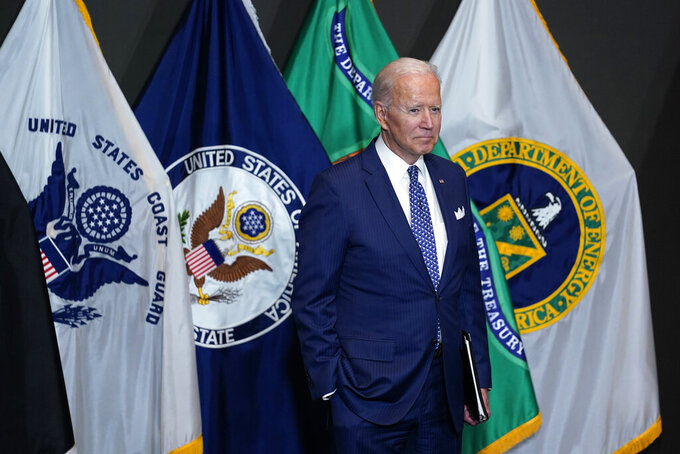 President Joe Biden listens as he is introduced to speak during a visit to the Office of the Director of National Intelligence in McLean, Va., Tuesday, July 27, 2021. This is Biden's first visit to an agency of the U.S. intelligence community. (AP Photo/Susan Walsh)