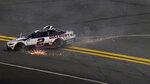 Brad Keselowski (2) slides to the bottom of the track after crashing during the second NASCAR Daytona 500 duel qualifying auto race Friday, Feb. 12, 2021, at the Daytona International Speedway in Daytona Beach, Fla. (AP Photo/Chris O'Meara)