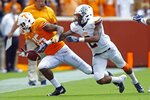 Tennessee wide receiver Jauan Jennings (15) loses control of the ball as he's defended by UTEP defensive back Michael Lewis (2) in the first half of an NCAA college football game Saturday, Sept. 15, 2018, in Knoxville, Tenn. (AP Photo/Wade Payne)