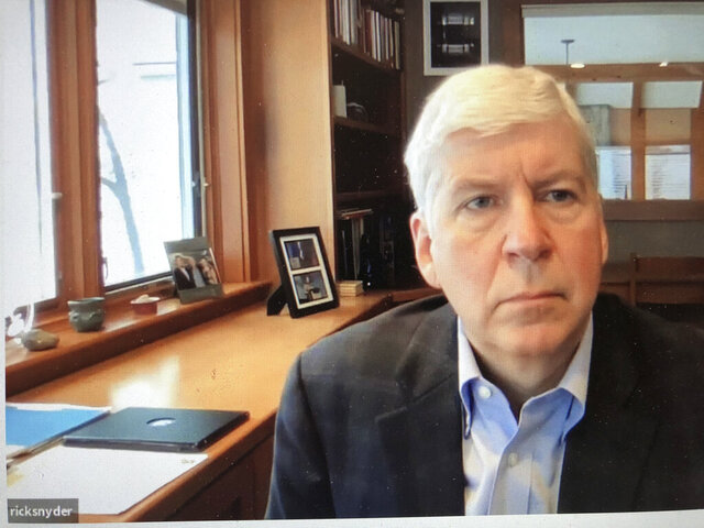 This screen shot from video, shows former Michigan Gov. Rick Snyder, during his Zoom hearing Tuesday, Jan. 18, 2020, in 67th District Court in Flint, Mich. Attorneys for Snyder are telling prosecutors that the Flint water case should be dismissed because he was charged in the wrong county. Snyder was charged last week with two misdemeanor counts of willful neglect of duty. (67th District Court in Flint via AP)
