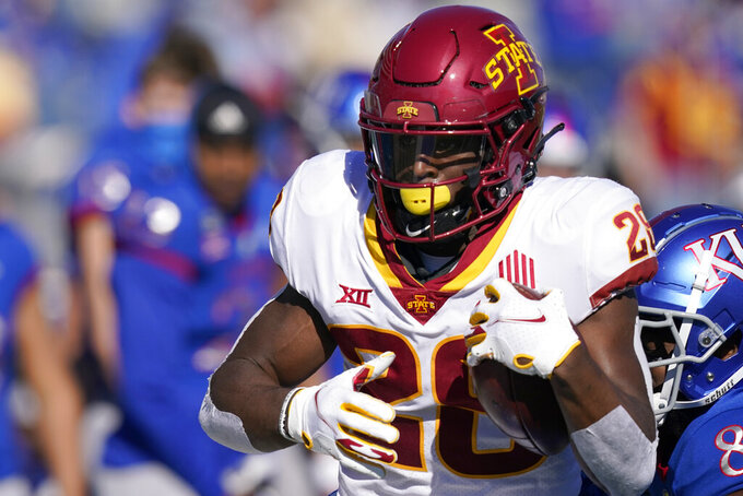Iowa State running back Breece Hall (28) gets past Kansas cornerback Kyle Mayberry (8) during the first half of an NCAA college football game in Lawrence, Kan., Saturday, Oct. 31, 2020. (AP Photo/Orlin Wagner)