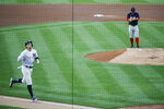 New York Yankees' Aaron Judge, left, runs the bases after hitting a solo home run off Boston Red Sox starting pitcher Zack Godley, right, during the first inning of a baseball game Saturday, Aug. 1, 2020, in New York. (AP Photo/John Minchillo)