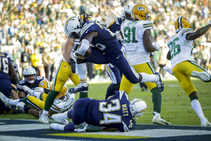 Los Angeles Chargers running back Melvin Gordon scores against the Green Bay Packers during the second half of an NFL football game Sunday, Nov. 3, 2019, in Carson, Calif. (AP Photo/Marcio Jose Sanchez)