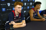FILE - In this Tuesday, Oct. 8, 2019, file photo, Arizona's Nico Mannion, left, and Josh Green speak during the Pac-12 NCAA college basketball media day in San Francisco.  The addition of five-star guards Nico Mannion and Josh Green have ratcheted up expectations in Tucson after the Wildcats missed the postseason last year.  (AP Photo/D. Ross Cameron, File)