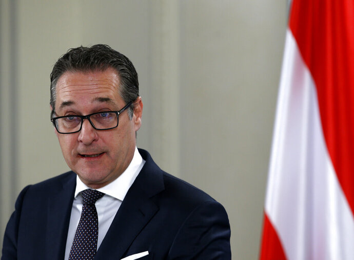 FILE - In this Feb. 12, 2018 file photo Austrian Vice-Chancellor Heinz-Christian Strache speaks during a press conference after talks with Serbian Foreign Minister Ivica Dacic in Belgrade, Serbia. Two German newspapers are reporting that the head of Austria's far-right Freedom Party offered government contracts in return for support for his party from a potential Russian donor shortly before the Austrian's 2017 parliamentary election. (AP Photo/Ronald Zak,file)