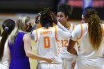 Tennessee coach Kellie Harper speaks to Rennia Davis (0) during a timeout in the team's NCAA college basketball game against Connecticut in Knoxville, Tenn., Thursday, Jan. 21, 2021. (Saul Young/Knoxville News Sentinel via AP, Pool)