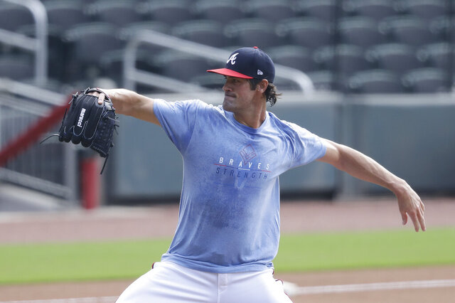 Atlanta Braves' pitcher Cole Hamels works out during a baseball practice at Truist Park on Friday, July 3, 2020, in Atlanta. (AP Photo/Brynn Anderson)