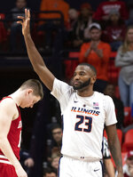 Illinois guard Aaron Jordan (23) waves to the crowd after being subbed out in his last home game, during the second half against Indiana in an NCAA college basketball game in Champaign, Ill., Thursday, March 7, 2019. (AP Photo/Stephen Haas)