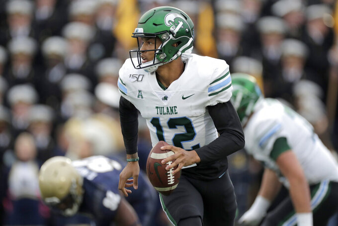 Tulane quarterback Justin McMillan looks to pass against Navy during the first half of an NCAA college football game, Saturday, Oct. 26, 2019, in Annapolis. (AP Photo/Julio Cortez)