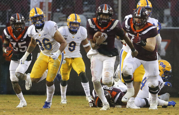 Virginia Tech quarterback Hendon Hooker (2) runs for first down in the first half of an NCAA college football game against Pittsburgh in Blacksburg Va. Saturday, Nov. 23 2019. (Matt Gentry/The Roanoke Times via AP)