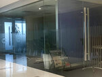 """The offices of China Innovation Investment Limited are seen in an office building in Hong Kong, Saturday, Nov. 23, 2019. Australia's Treasurer on Saturday labeled detailed accusations of China infiltrating and disrupting democratic systems in Australia, Hong Kong and Taiwan as """"very disturbing"""". A Chinese defector revealed he was part of the Hong Kong-based investment firm, which was a front for the Chinese government to conduct political and economic espionage in Hong Kong, including infiltrating universities and directing bashings and cyber attacks against dissidents. (AP Photo/Ng Han Guan)"""