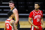 Iowa center Luka Garza, top left, reacts after drawing a foul in the first half of an NCAA college basketball game as Ohio State forward Seth Towns (31) looks on Thursday, Feb. 4, 2021, in Iowa City, Iowa. (Joseph Cress/Iowa City Press-Citizen via AP)