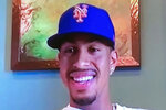 This screen grab from a Zoom call on Monday, Jan. 11, 2021, shows four-time All-Star Francisco Lindor smiling while wearing a New York Mets baseball team hat. Lindor was traded to the Mets from the Cleveland Indians.(New York Mets via AP)