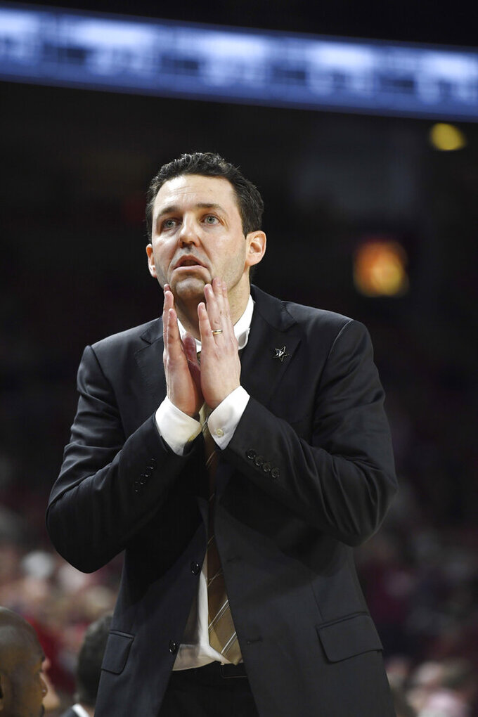 Vanderbilt coach Bryce Drew reacts to a play against Arkansas during the second half of an NCAA college basketball game, Tuesday, Feb. 5, 2019 in Fayetteville, Ark. (AP Photo/Michael Woods)