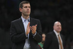 Boston Celtics head coach Brad Stevens applauds his players during the first half of an NBA basketball game against the Chicago Bulls in Boston, Monday, Jan. 13, 2020. (AP Photo/Charles Krupa)