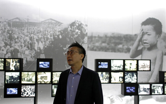 "Flim director Kim Deog-Young speaks during an interview at the exhibition hall for Korean War in Seoul, South Korea Friday, May 29, 2020. His film ""Kim Il Sung's Children"" —  referring to North Korea's founder and wartime leader — will be released June 25, the 70th anniversary the Korean War's start. The three-year conflict destroyed much of North and South Korea, killed more than 1 million people and orphaned an estimated 100,000 children.(AP Photo/Lee Jin-man)"