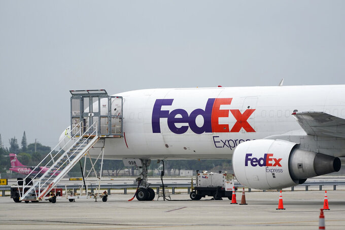 A FedEx cargo plane is shown on the tarmac at Fort Lauderdale-Hollywood International Airport, Tuesday, April 20, 2021, in Fort Lauderdale, Fla. FedEx is getting hurt by the tight job market. The package delivery company said Tuesday, Sept. 21 that its costs are up $450 million in the most recent quarter, as it paid higher wages as it got harder to find new workers and demand for shipping increased. (AP Photo/Wilfredo Lee)