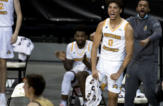 Northern Kentucky guard Trey Robinson (0) cheers after a basket by John Harge during the second half of the team's NCAA college basketball game against Purdue-Fort Wayne on Friday, Jan. 1, 2021, in Highland Heights, Ky. (Albert Cesare/The Cincinnati Enquirer via AP)