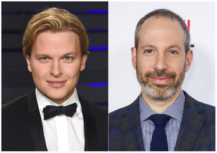 This combination photo shows Pulitzer Prize-winning writer Ronan Farrow at the Vanity Fair Oscar Party in Beverly Hills, Calif. on Feb. 24, 2019, left, and NBC News President Noah Oppenheim at the 2016 AFI Festival