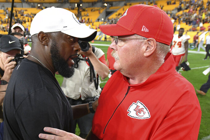 Pittsburgh Steelers coach Mike Tomlin, left, talks with Kansas City Chiefs coach Andy Reid after a preseason NFL football game Saturday, Aug. 17, 2019, in Pittsburgh. The Steelers won 17-7. (AP Photo/Barry Reeger)