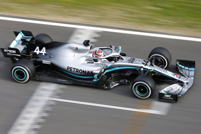 Mercedes driver Lewis Hamilton of Britain steers his car, during a Formula One pre-season testing session at the Barcelona Catalunya racetrack in Montmelo, outside Barcelona, Spain, Wednesday, Feb.20, 2019. (AP Photo/Joan Monfort)