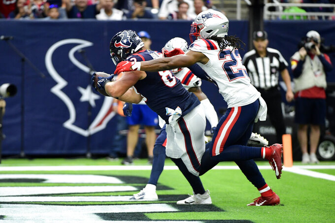 Houston Texans tight end Antony Auclair (83) catches a pass for a touchdown as New England Patriots safety Kyle Dugger (23) defends during the first half of an NFL football game Sunday, Oct. 10, 2021, in Houston. (AP Photo/Justin Rex)