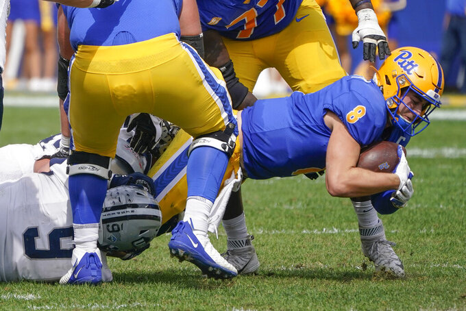 Pittsburgh quarterback Kenny Pickett (8) is sacked by New Hampshire linebacker Justin Jameson (9) during the first half of an NCAA college football game, Saturday, Sept. 25, 2021, in Pittsburgh. (AP Photo/Keith Srakocic)