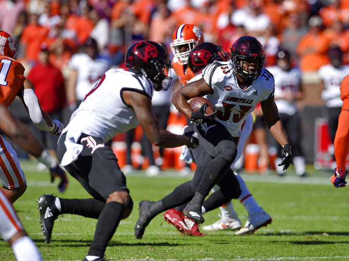 Louisville's Colin Wilson rushes during the first half of an NCAA college football game against Clemson, Saturday, Nov. 3, 2018, in Clemson, S.C. (AP Photo/Richard Shiro)